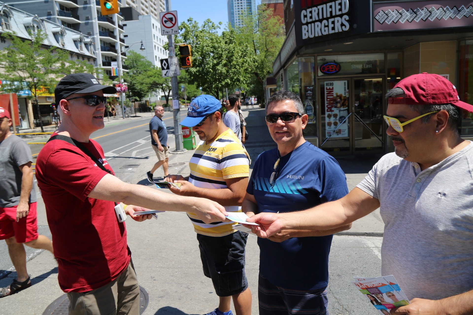 """I represent the vegan gay army,"" says Tom Tkach as he gives literature to Jerardo Flores on Church Street."