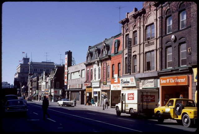 View of stores, including the Parkside and St. Charles Taverns, on Yonge Street south of Wellesley, June 10, 1971. Photo by Harvey Naylor. City of Toronto Archives,  Fonds 1526, File 2, Item 68.