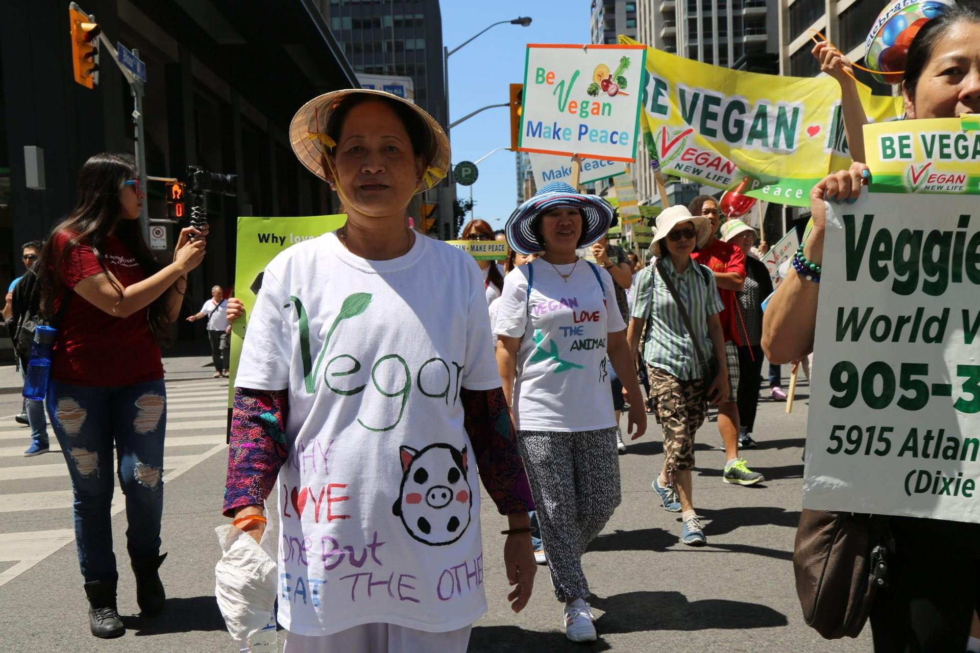 """Support veganism and love animals"" says Nga Ma marching with the Supreme Master Ching Hai Meditation Association."