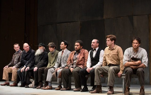 Actors, from left to right, Stuart Hughes, Diego Matamoros, Robert Nasmith, Courtney Ch'ng Lancaster, Kawa Ada, Peter Fernandes, Alex Poch-Goldin, Gordon Hecht, and Meegwun Fairbrother in Soulpepper Theatre's Incident at Vichy.  Photo by Cylla von Tiedemann.