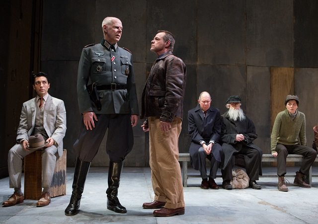 Oliver Dennis as the Major and Stuart Hughes as Leduc with, in the background, Kawa Ada, Diego Matamoros, Robert Nasmith, and Courtney Ch'ng Lancaster, in a scene from Incident at Vichy. Photo by Cylla von Tiedemann.