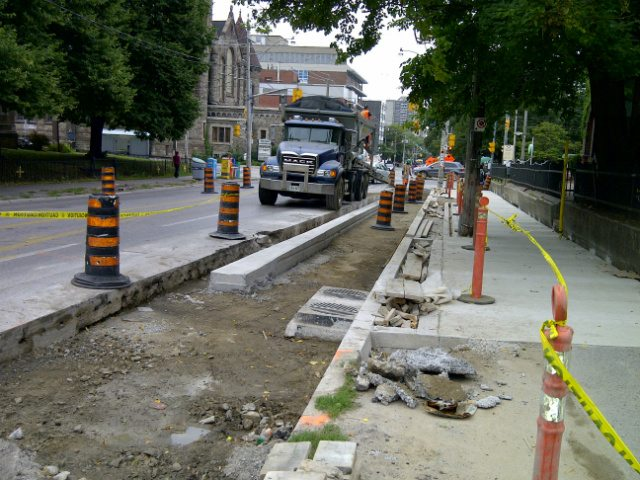 Photo of the Sherbourne cycle track courtesy of the City of Toronto.