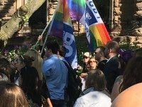 Parents at the Queen's Park flag raising gathered to address LGBTQ parental rights.