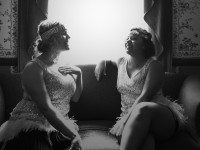 Hogtowns Aisha Jarvis and Laura Larson play 1920s showgirls in Campbell Houses basement speakeasy. Photo by Joseph Hammond.