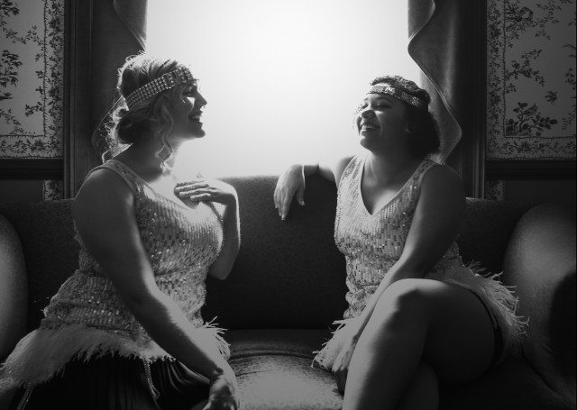 Hogtown's Aisha Jarvis and Laura Larson play 1920's showgirls in Campbell Houses basement speakeasy. Photo by Joseph Hammond.