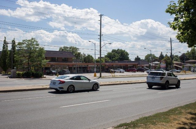 View of the plaza looking south on Ellesmere Road. To the east are two gas stations: one on each southern corner of Ellesmere Road. Homes slated for potential expropriation are directly south of the area. Photo by Anders Marshall .