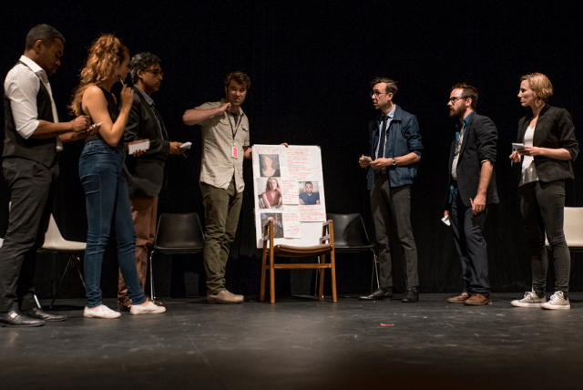 A scene from True Blue. Left to Right: Kevin Vidal, Shanda Bezic, Anand Rajaram, Jon Blair, Colin Munch, Danny Pagett, and Mikaela Dyke. Photo by Michael Meddik.