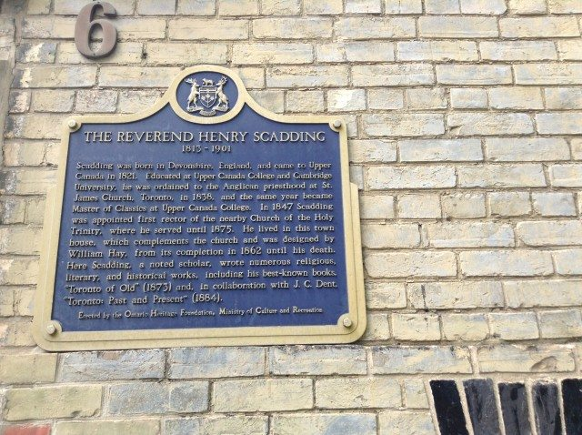 A plaque Rev. Henry Scadding on his old house, next to Holy Trinity Church and the Eaton Centre. Photo by Erin Sylvester.