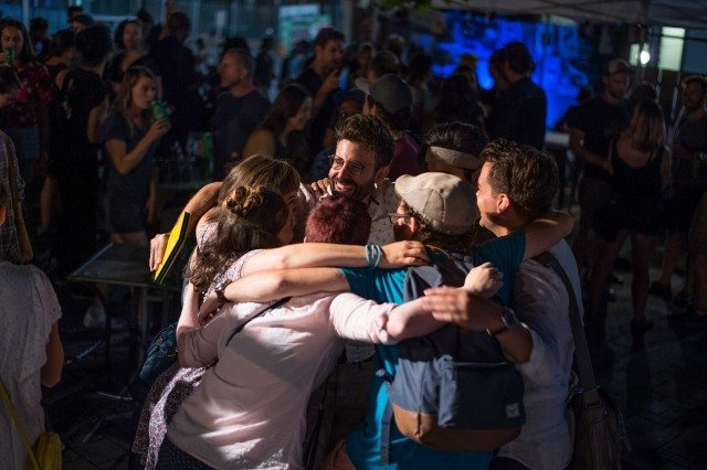 James Smith gets a group hug from his Lessons In Temperament creative team after they won the Best Production award. Photo by Dahlia Katz/SummerWorks.