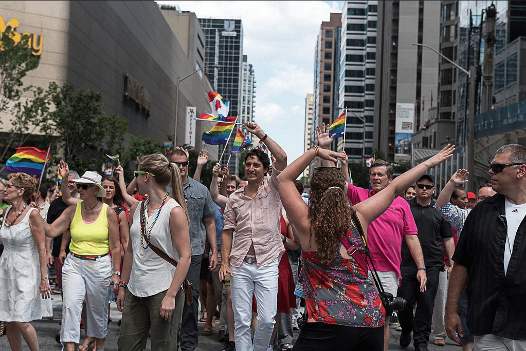 Justin Trudeau marches in Toronto Pride. The Prime Minister was criticized in anti-gay literature by Bill Whatcott. Photo by Scorpion Lens from the Torontoist Flickr Pool.