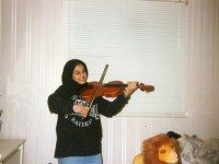 The author playing her violin.