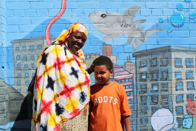 Aliya and one of her children, residents of Moss Park Photo by Alma Ahmed