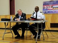 Toronto Police Chief Mark Saunders and Toronto Police Services Board chair Andy Pringle take questions from the audience at Wednesday night's meetings. Photo by Rhiannon Russell.
