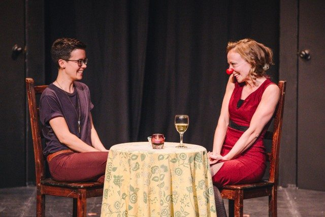 Julie Orton (red nose) meets a blind date for the first time on stage. Photo by Connie Tsang.