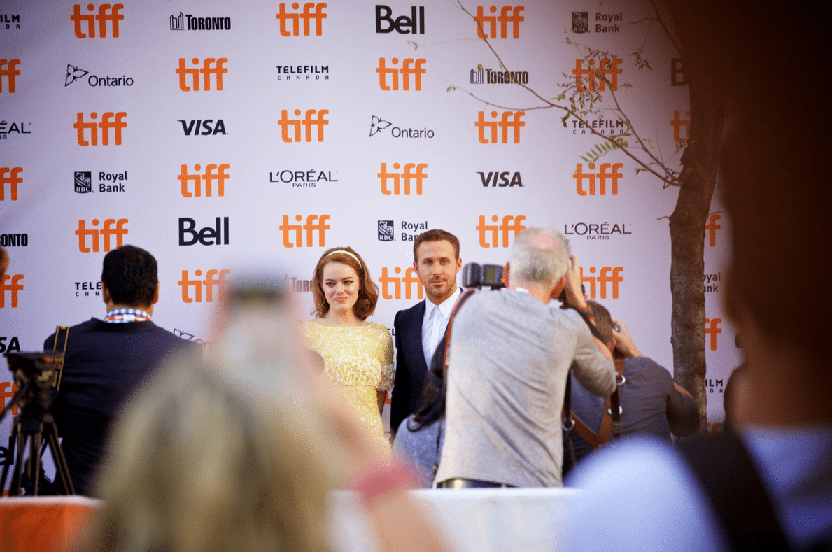 Emma Stone and Ryan Gosling, stars of La La Land, pose for photos in Toronto. Photo by Jason Cook from the Torontoist Flickr Pool.