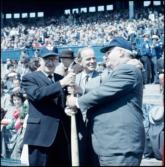 At various times, the public thought any of these three men were clowns. Mayor Nathan Phillips, Maple Leafs owner Jack Kent Cooke, and Metro Toronto Chairman Frederick Gardiner, probably taken at opening day at Maple Leaf Stadium in May 1960. City of Toronto Archives, Fonds 1257, Series 1057, Item 2624.