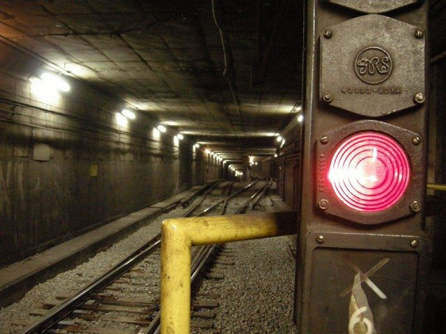A red light in the subway tunnel at St. George station. The driver of Run 35 passed three lights before colliding with a train stopped just north of Dupont station, causing the TTC's worst subway crash. Photo by Mike Hoye in the Torontoist Flickr Pool.