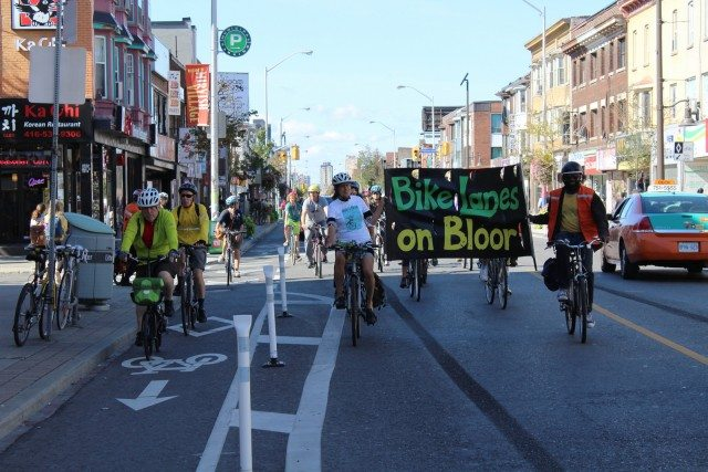 Cyclists celebrate the new Bloor Street bike lanes with a victory lap in September. Photo by  Robert Zaichkowski from the Torontoist Flickr Pool.