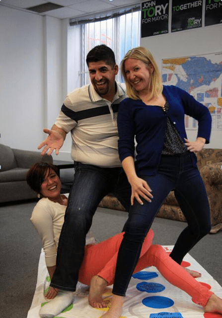 "Photo from the 2014 campaign, when Nick Kouvalis, centre, played ""Twister Chow"" to mock the candidate's allegedly evolving stance on the Downtown Relief Line."