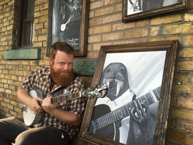 Garrett Jamieson (pictured, with banjo) and Charlotte Mars's artwork. Photo by Hannan Younis.