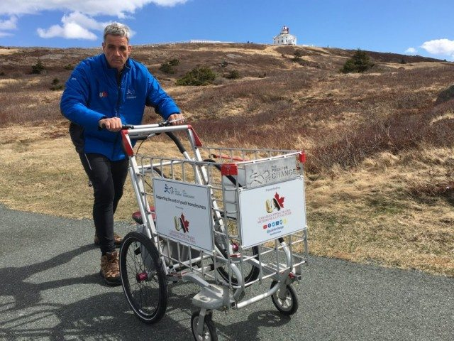 Joe Roberts is pushing a shopping cart across Canada to raise money awareness about youth homelessness. Photo courtesy of The Push for Change.