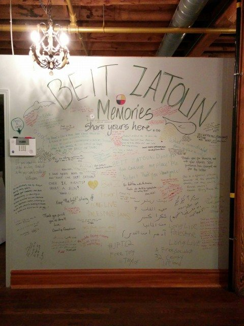 Attendees share their memories of time spent at Beit Zatoun on a wall at the centre. Photo by Amanda Ghazale Aziz.