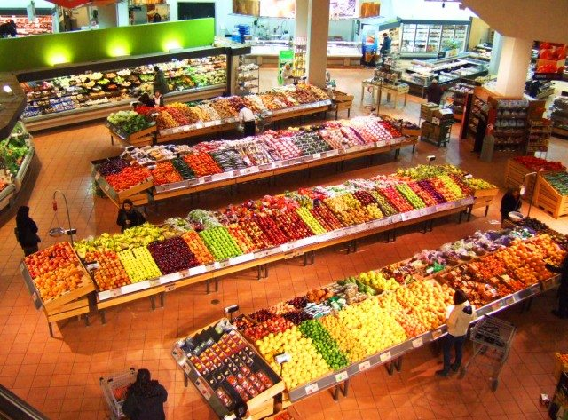 A supermarket's produce section. Photo by kaeko from the Torontoist Flickr Pool.