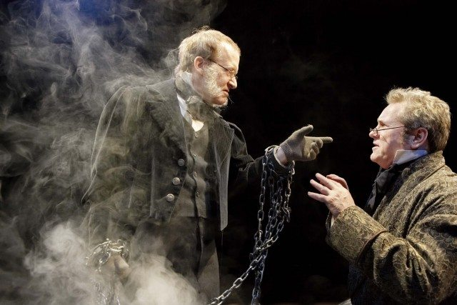 John Jarvis as Jacob Marley and Joseph Ziegler as Scrooge. Photo by Sandy Nicholson.