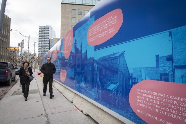 """Picturing the Ward"" is wraps around the construction site for the new Toronto Courthouse. The land was once home to a black congregation, which had served as a refuge for those escaping slavery via the Underground Railroad. Photo: Sharon Mendonca 
