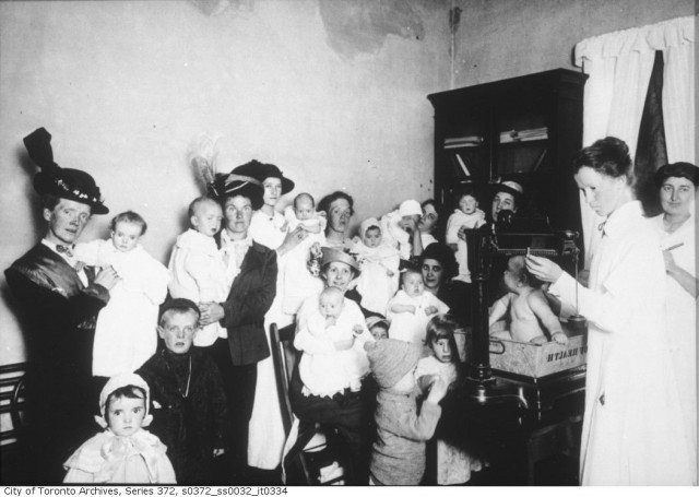 A baby clinic at St. Christopher House, now West Neighbourhood House, in September 1914. Some of these babies could have been born at Burnside. Photo from the Toronto Archives, fonds 200, Series 372, Subseries 32, Item 334.