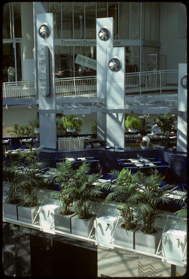Interior view of tables and some stores in new Eaton Centre. Photo by Harvey R. Naylor, May 25, 1977. City of Toronto Archives, Fonds 1526, File 92, Item 5.