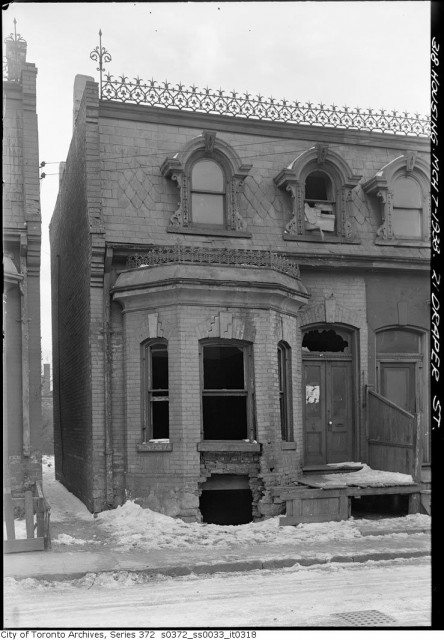 21 Draper Street in March 1938 before it was demolished. This lot if now the site of a community parkette. Photo from the City of Toronto Archives Fonds 200, Series 372, Subseries 33, Item 318.