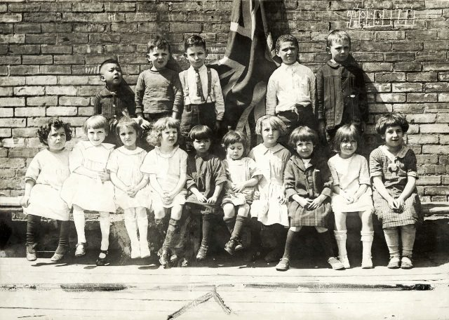 """Students at York St. Public School. """"More than a dozen races are represented in this group of children."""" Courtesy of Toronto Public Library."""