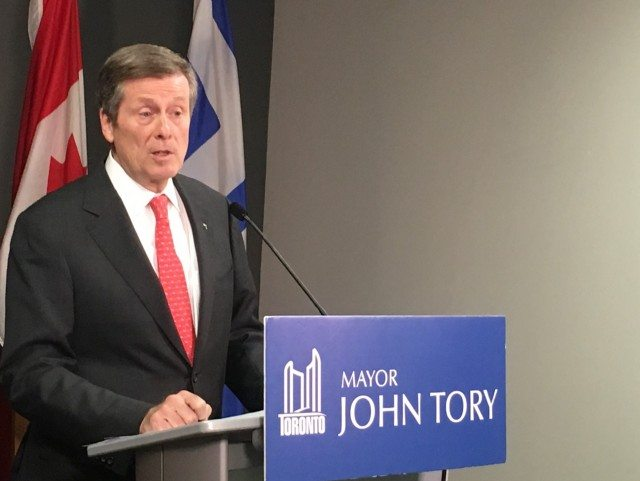 John Tory addresses reporters after a roundtable discussion on housing. Photo by Tannara Yelland.