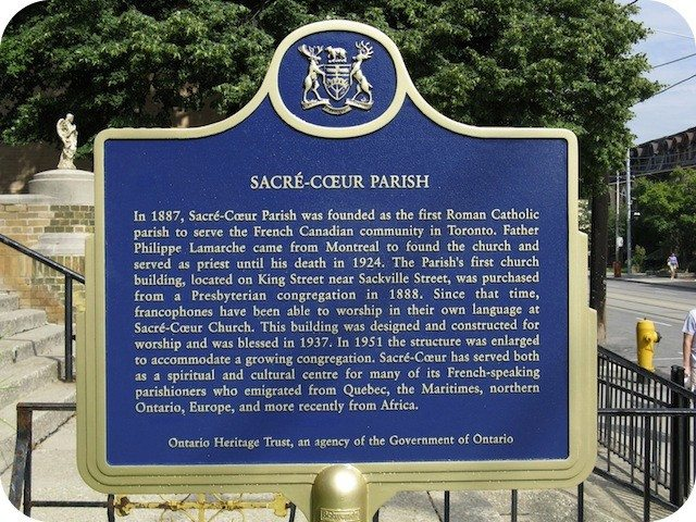 The plaque outside Sacré-Coeur Parish at Sherbourne and Carlton. Photo by Wayne Adam for torontoplaques.com.