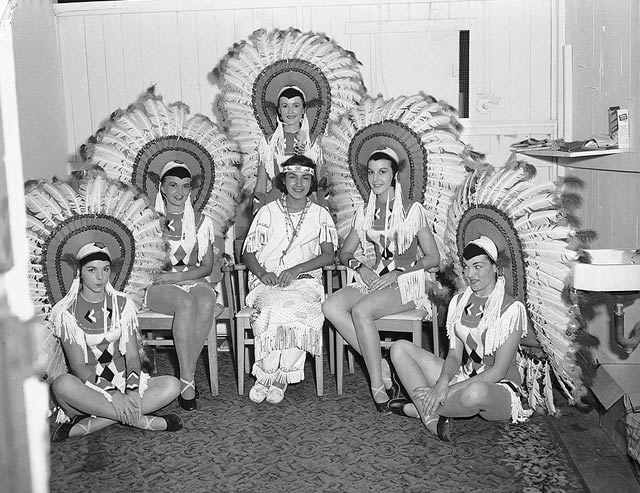 We've (hopefully) come a long way from this sort of thing. Women in costumes with Indian motifs, CNE, 1956. City of Toronto Archives, Fonds 1257, Series 1057, Item 5779.