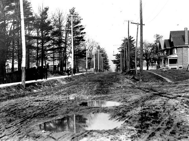 "Muddy St. Clair Avenue West, east of Avenue Road, 1910. City of Toronto Archives, Fonds 1244, Item 19. A researcher's note on the back of the photograph reads, ""This photo appeared in the Toronto World, Sunday, May 15, 1910, under heading 'Beautiful Toronto Street Much Favored by Horsemen, Cyclists and Pedestrians–Three Views of St. Clair-avenue.'"" Based on this photo, we're guessing the copywriter had their tongue firmly in cheek."