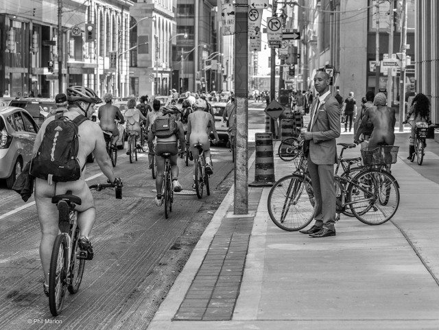 The naked bike ride along Bay Street in 2015. Photo by Phil Marion in the Torontoist Flickr Pool.