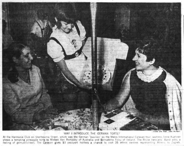 At the German pavilion, Irene Kuehner offers a pineapple torte to Mieken van Rompaey of Australia and Bernadette Foley of Ireland.  Globe and Mail, June 25, 1970.  Photo by John McNeill.