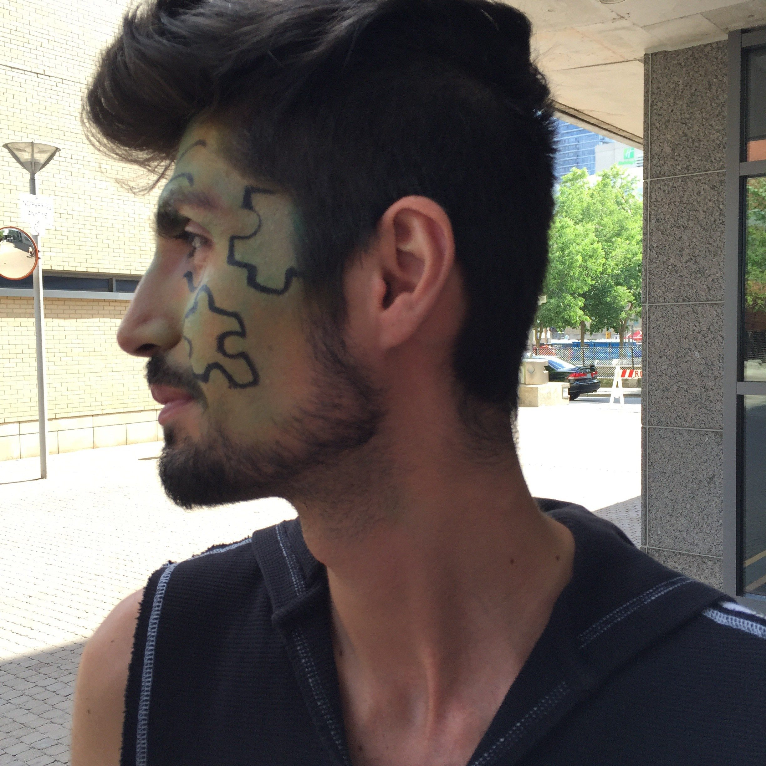 Mohammed with puzzle pieces painted by his now-fiancé at Pride in 2016.