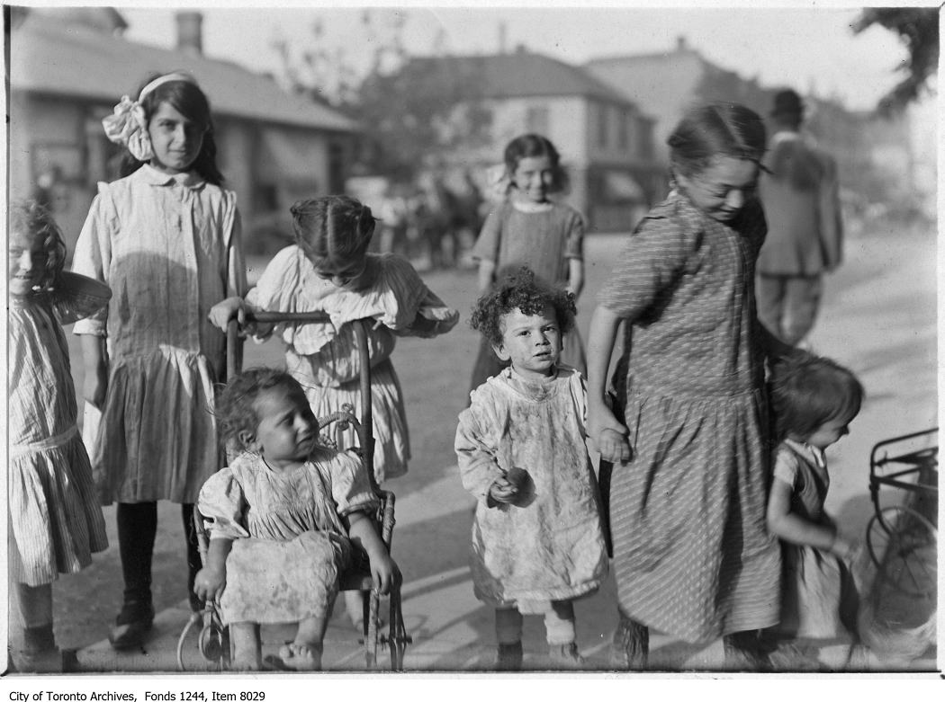 Children play in The Ward c. 1911. Photo from the City of Toronto Archives Fonds 1244, Item 8029.