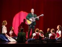 Baron Von Trapp (Nicholas Rodriguez) plays Edelweiss surrounded by his children in  The Sound Of Music .  Photo by Matthew Murphy.