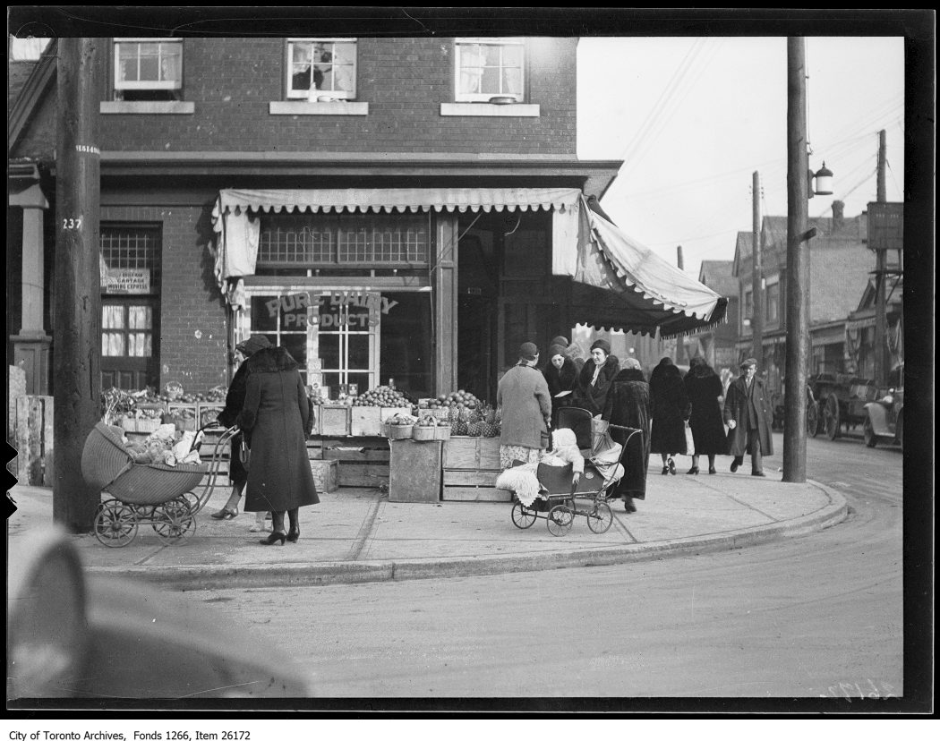 Women at a fruit store in the Jewish market on Kensington Avenue in January 1932. Photo from the City of Toronto Archives Globe and Mail fonds, Fonds 1266, Item 26172.