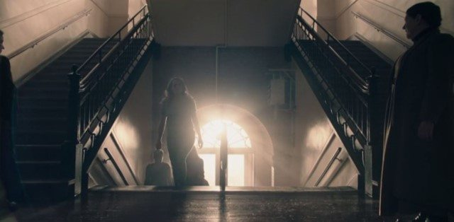 June (Elisabeth Moss) and Aunt Lydia (Ann Dowd) in an interior scene at the Red Centre. The Handmaid's Tale shot at King George School.