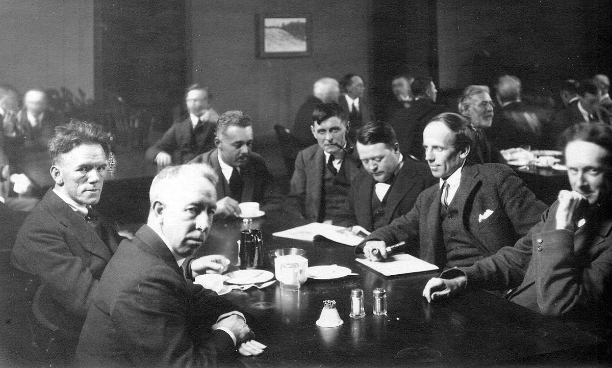 The Group of Seven in  the Great Hall of the Arts and Letters club c. 1920. Photo via Wikimedia Commons.