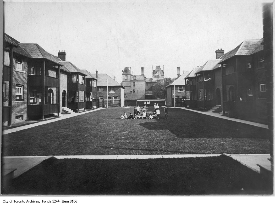 Spruce Court as designed and built by Eden Smith in 1913 for the Toronto Housing Company, inner courtyard, c. 1920. Photo from the City of Toronto Archives, Fonds 1244, Item 3106.