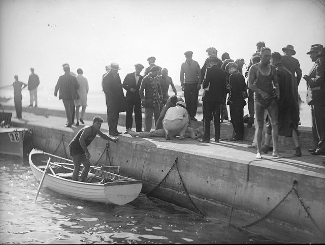 A swimmer (definitely not Ernst Vierkoetter) being resuscitated during the 1927 race.  City of Toronto Archives, Fonds 1266, Item 11422.