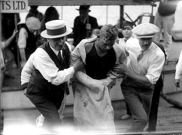 George Young being helped from the water, August 31, 1927.  City of Toronto Archives, Fonds 1266, Item 11432.