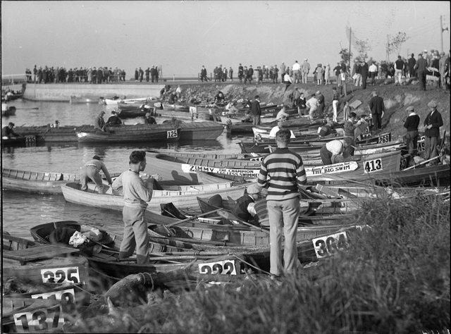 "The rowboats for the August 31, 1927 marathon.  One is clearly marked ""Zimmy, the champion legless swimmer.""  City of Toronto Archives, Fonds 1266, Item 11414."