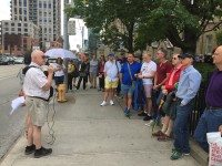 The Pride Outside the Village walking tour listens to historical tales on the final stop. Photo by Scott Dagostino.